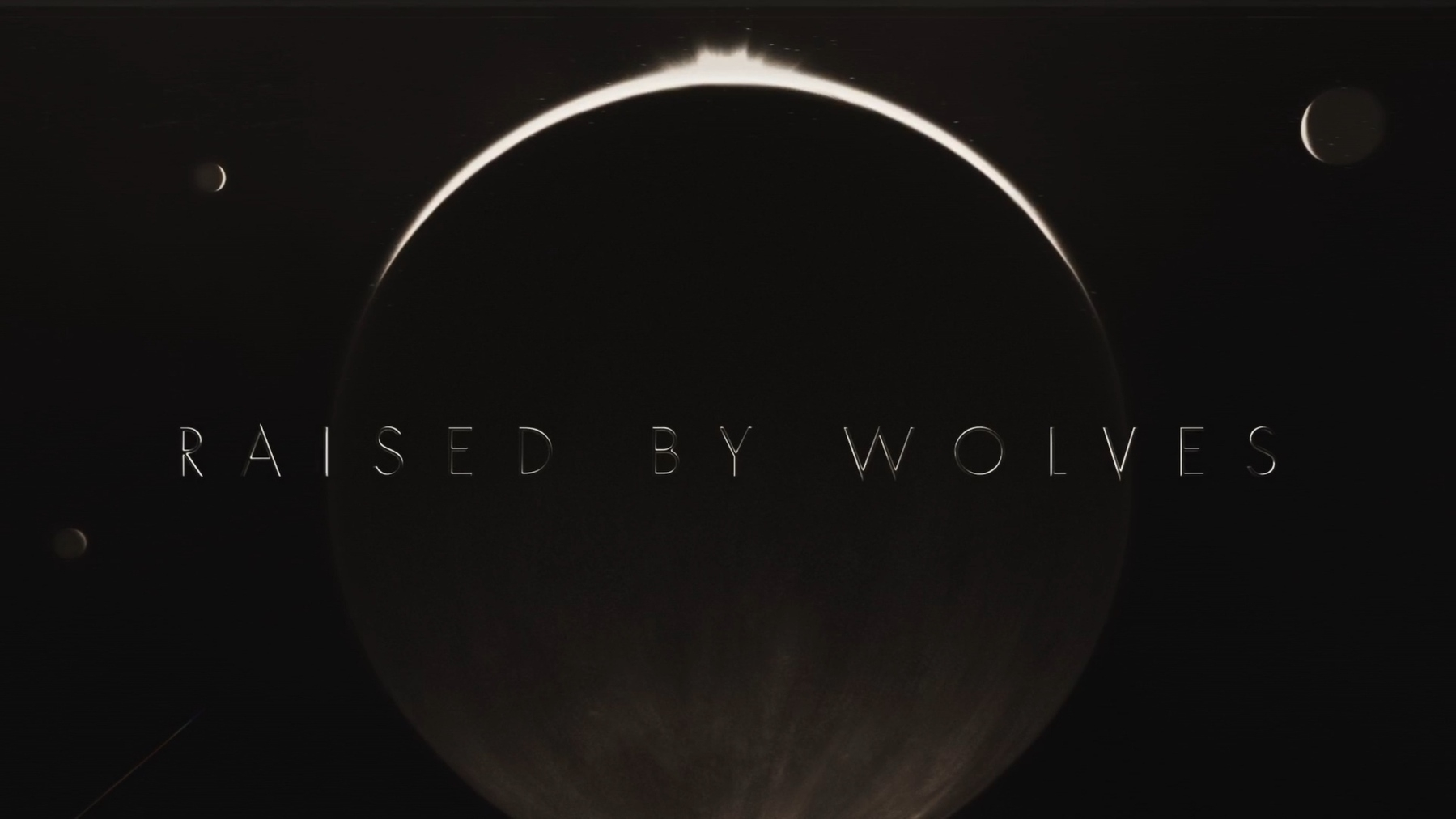 The title card for the tv show, Raised by Wolves.