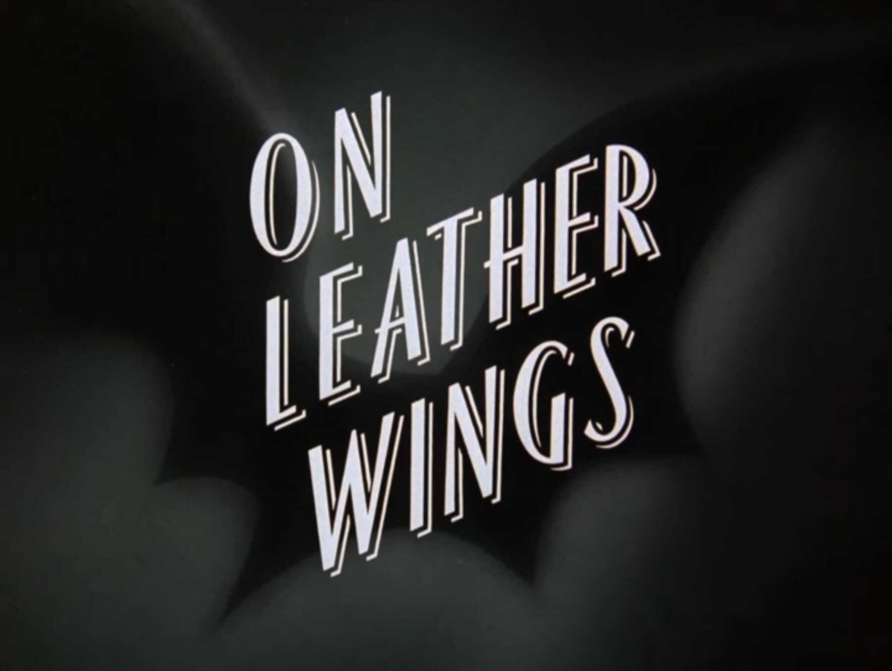 The title card for On Leather Wings. It shows bat wings in silhouette behind stylized title text for the episode.