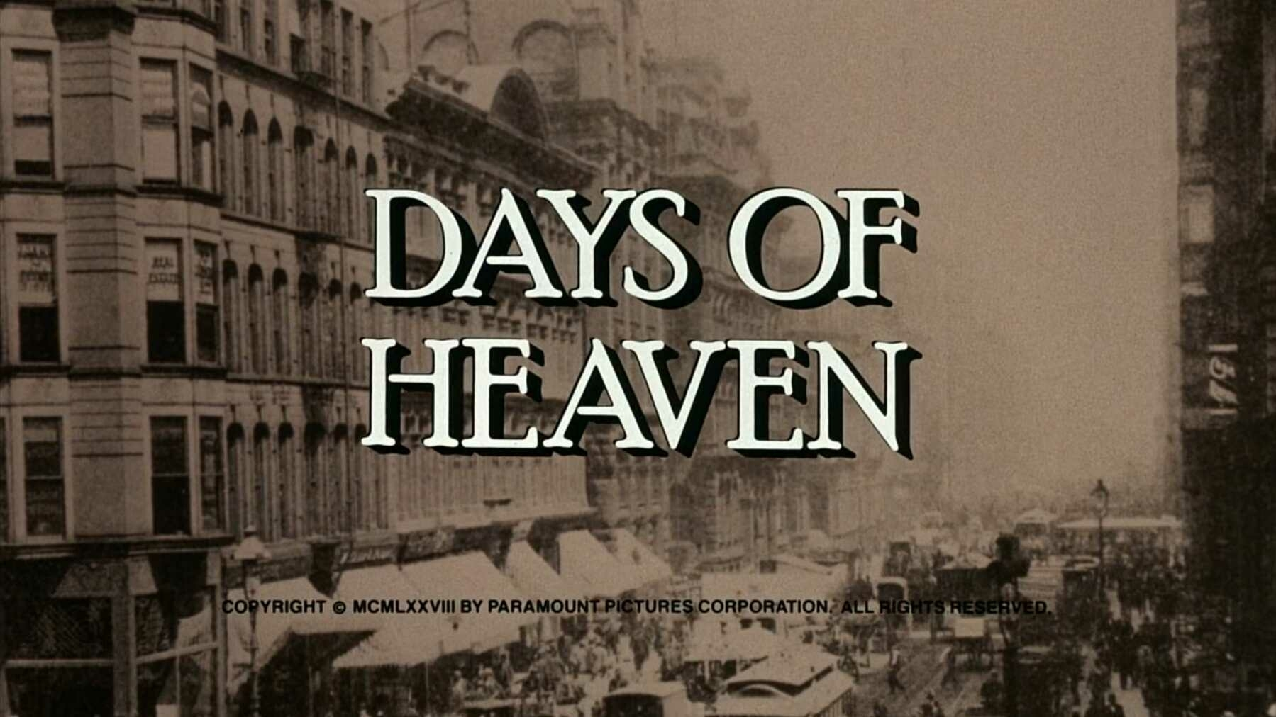 The title card for the film, Days of Heaven, featuring an old photo of a city street behind text.