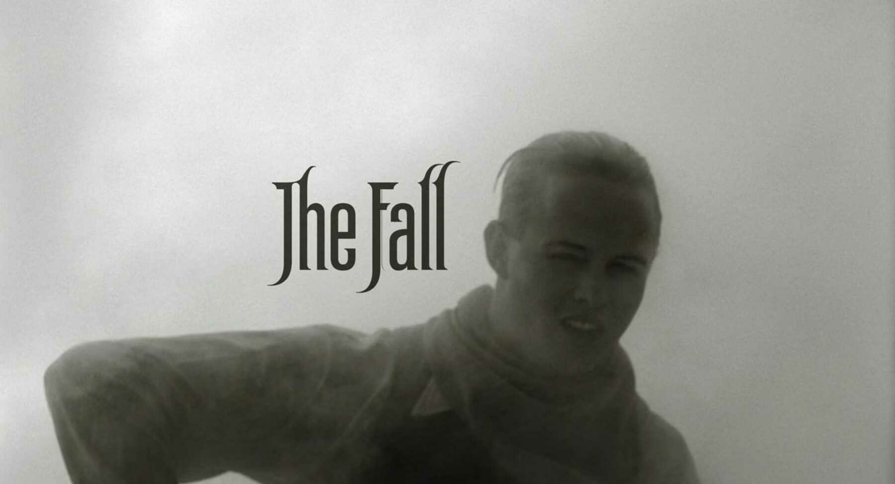 A man enshrouded in thick and heavy steam with the title card of the film, The Fall, shown next to his head.